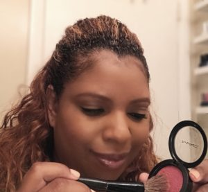 black women applying MAC blush