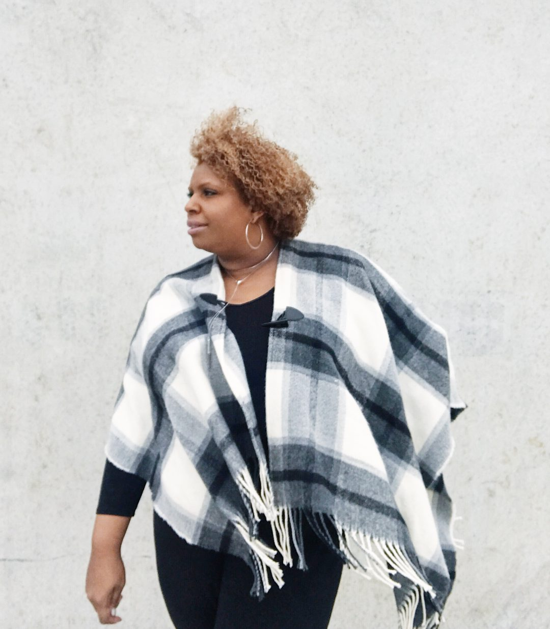 black and white sweater poncho outfit