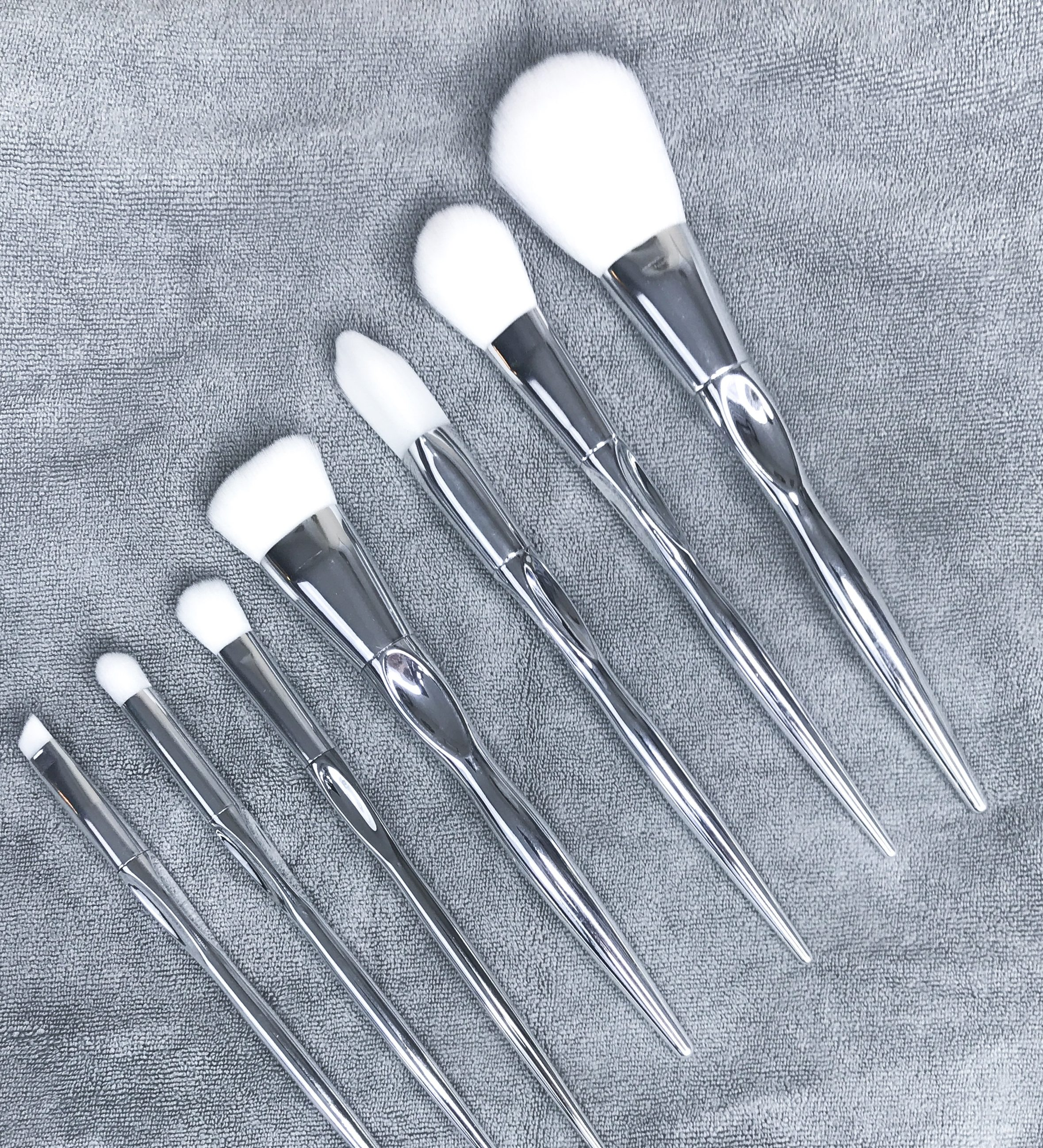 silver and white hair makeup brushes